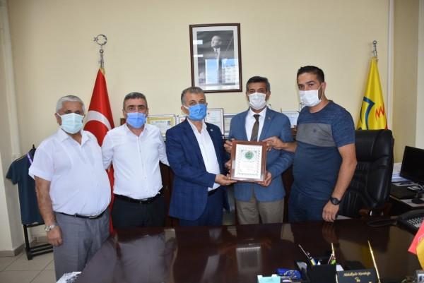 MTDF'DEN, PTT MARDİN BAŞ MÜDÜRÜ KARABOĞA'YA TEŞEKKÜR PLAKETİ